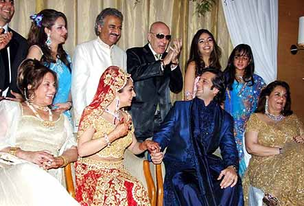 The entire family gets together to bless the newly weds