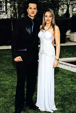 Fardeen in a black suit and Natasha in a shimmering, figure-hugging white outfit